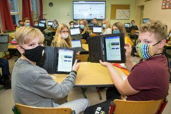 Statt Schulbücher ein Tablet im Ranzen