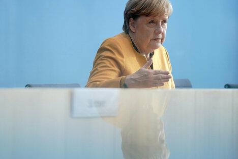 Merkel: Einschränkungen als Wellenbrecher