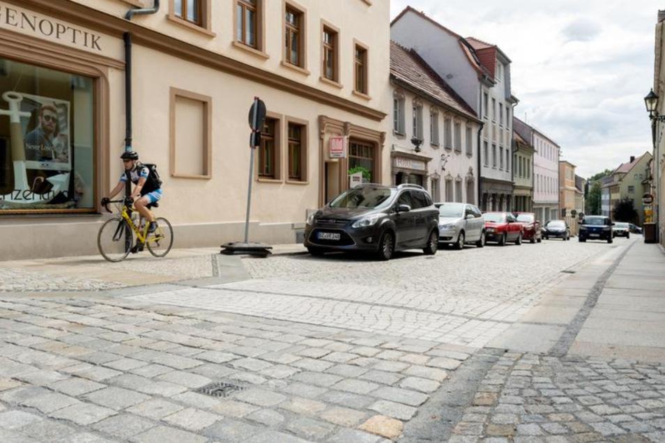Die Bahnhofstraße ist nach der Sanierung wieder für den Verkehr freigegeben. Am 8. September wird sie noch einmal gesperrt, dann um zu feiern. Geschäftsleute organisieren ein Straßenfest.