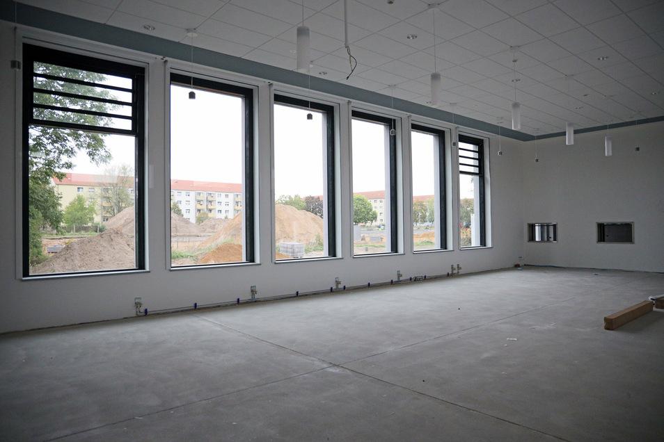 Die alte Turnhalle wird der neue Speiseraum. Mit den hohen Fenstern ist sie auch als Aula attraktiv - und soll auch von Anwohnern genutzt werden können.