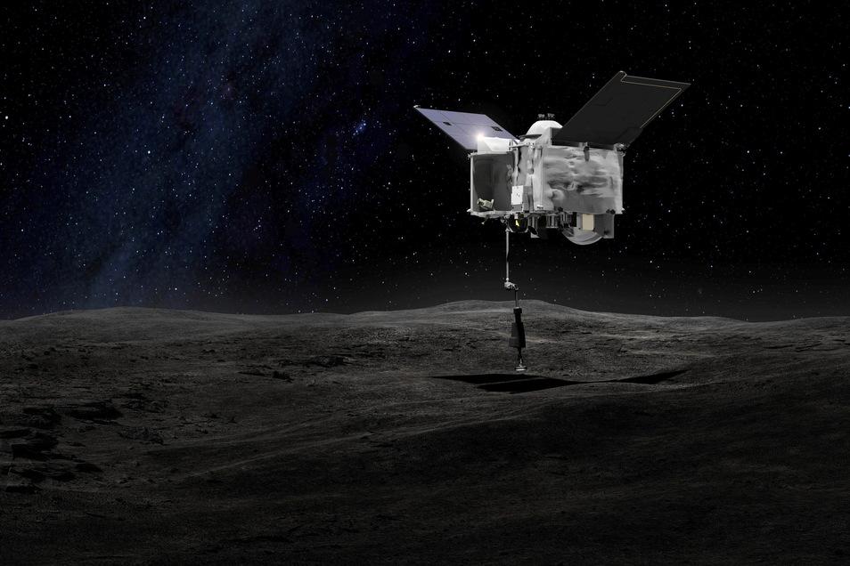 Diese NASA-Illustration zeigt die Sonde «Osiris-Rex» auf dem Asteroiden Bennu