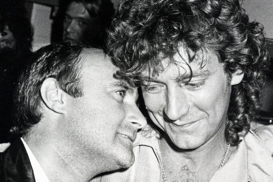 Phil Collins 1983 zusammen mit Robert Plant auf einer Party. Andere Kollegen hatten hingegen immer wieder Probleme mit ihm.
