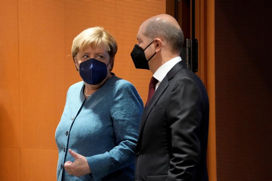 Angela Merkel und Olaf Scholz.