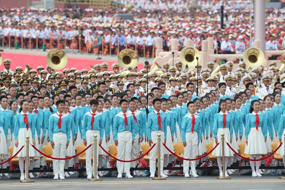 Ein Chor auf dem Platz des Himmlischen Friedens in Peking.