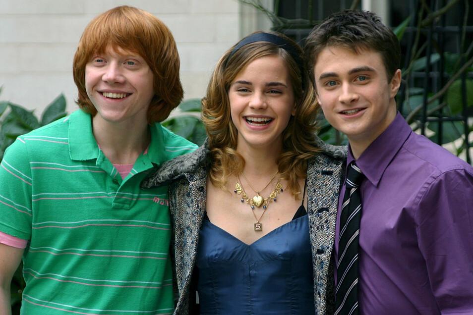 Rupert Grint (links) mit Emma Watson  und Daniel Radcliffe  im Jahr 2005.