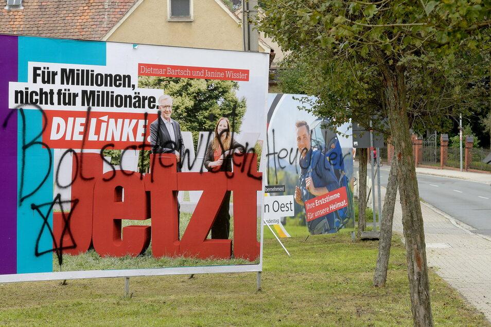 Die besprühten Wahlplakate von Die Linke und von der CDU in der Nordstraße in Seifhennersdorf.