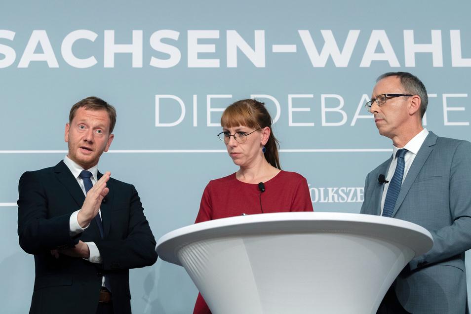 Am 21. August stellen sich die sechs Spitzenkandidaten der großen Parteien einer öffentlichen Debatte. Hier ist Katja Meier mit Sachsens Ministerpräsident Michael Kretschmer (CDU undJörg Urban, Spitzenkandidat der AfD, (r.) auf der Bühne.