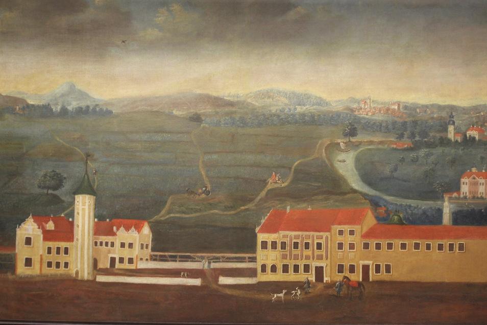 Die Zeichnung zeigt das Riesaer Rittergut um das Jahr 1800 herum. Riesa hatte zu diesem Zeitpunkt schon 177 Jahre lang das Stadtrecht inne. Das kleine Foto unten zeigt die Stadtrechtsurkunde aus dem Jahr 1623.