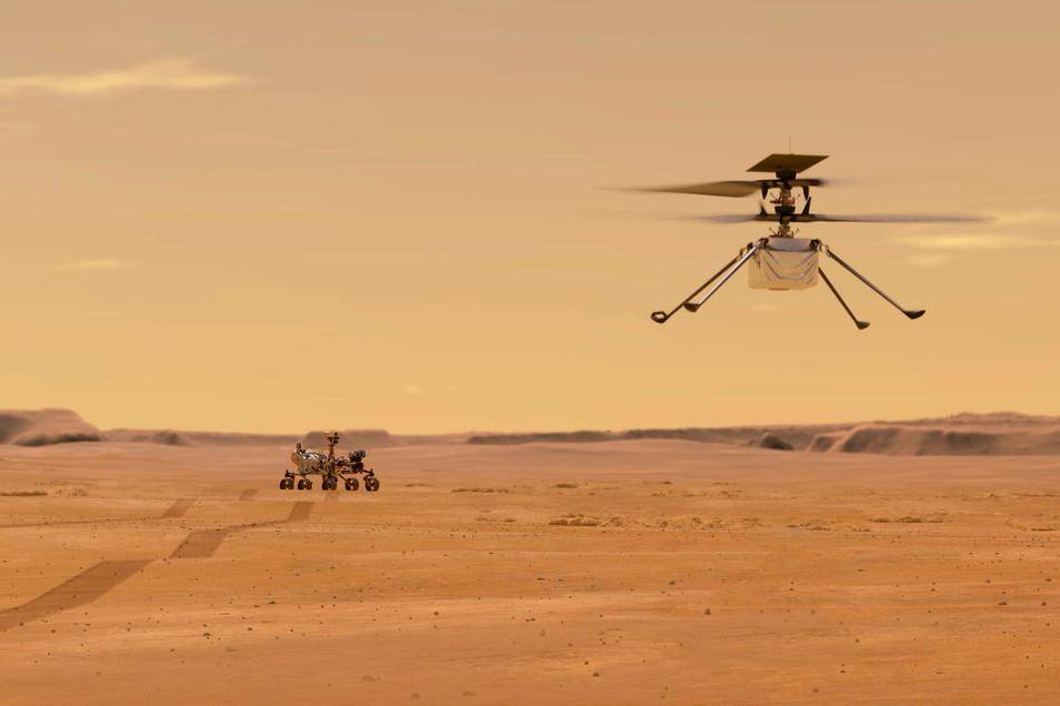 """Der Nasa-Rover """"Perseverance"""", der am Donnerstag auf dem Mars gelandet ist, hat neben einem Hubschrauber - der hier gerade startet - auch eine sorbische Botschaft an Bord."""
