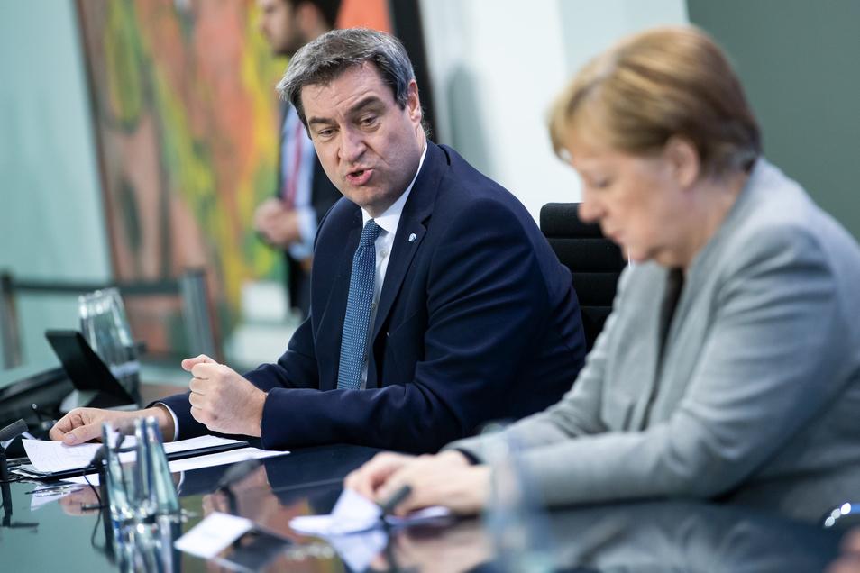 CSU-Chef Söder und Kanzlerin Merkel informieren zur Corona-Krise.