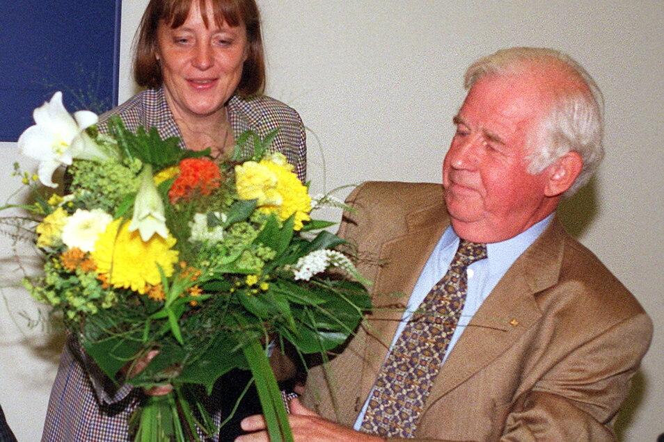 1999 mit der damaligen CDU-Generalsekretärin Angela Merkel.