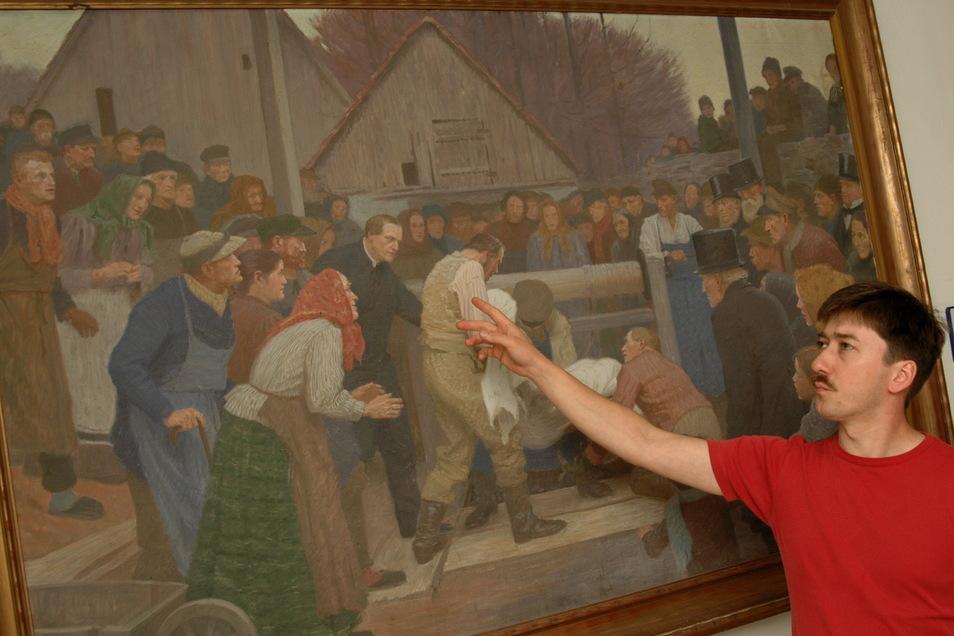 Der Ponickauer Pfarrer Frank Dregennus am Bild des Brunnenwunders.
