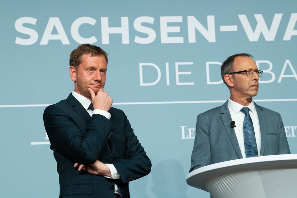 Der von der AfD angezeigte Michael Kretschmer (CDU) und Jörg Urban, Spitzenkandidat der AfD zur Landtagswahl.