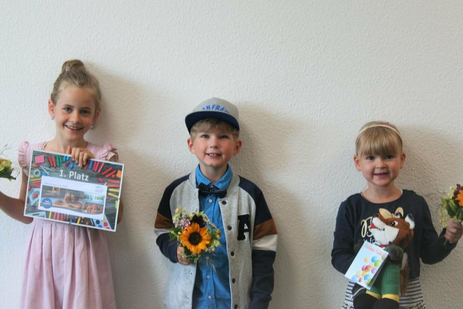 Die drei Gewinner des Malwettbewerbes der EKM : Hannah aus Großschirma, Luis aus Waldheim und Nelia aus Halsbrücke.