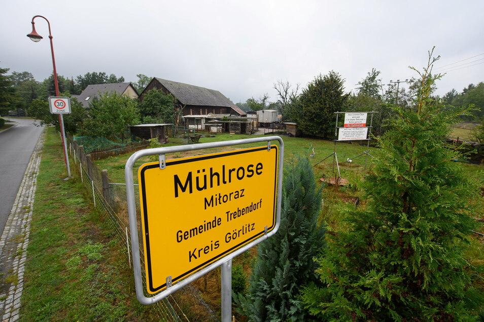 Das Ortseingangschild von Mühlrose. Der Ort soll der Braunkohle weichen - ist das nötig?