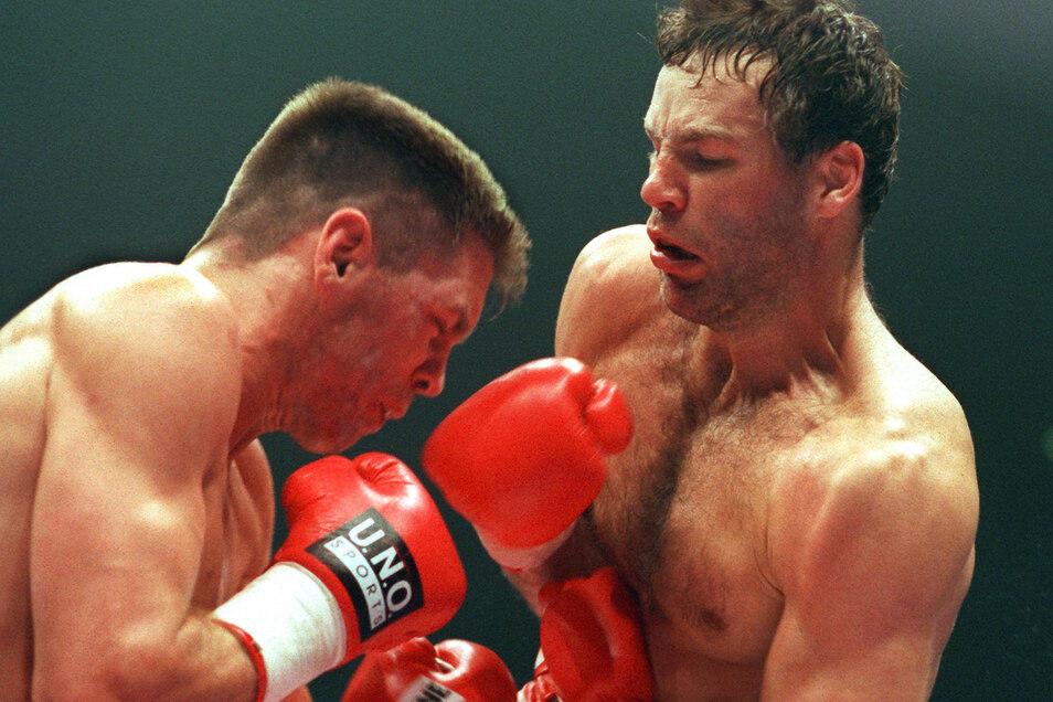 Weltmeister Henry Maske (rechts) gewann den deutsch-deutschen WM-Kampf vor 25 Jahren gegen Graciano Rocchigiani. Erst viel später freundeten sich beide Boxer an.