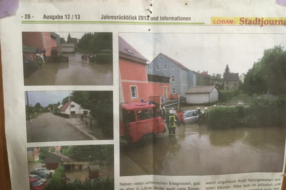 Dieser Zeitungsartikel erinnert noch an die Überflutung. Das große Bild zeigt, wie die Feuerwehr das Auto von Horst Schneider aus der Garage birgt.