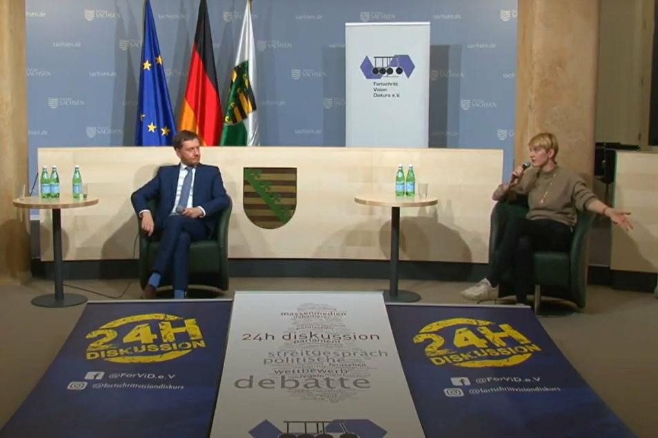 Ministerpräsident Michael Kretschmer und Sophie Koch (Landesvorsitzende der JuSos Sachsen) im Gespräch über die Probleme der Jugend in Zeiten der Pandemie