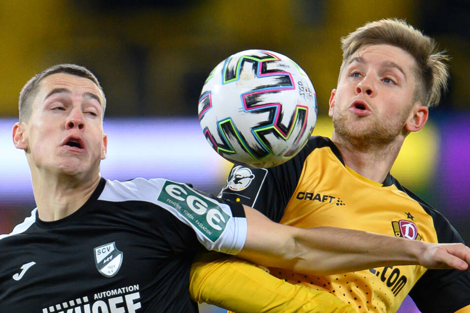 Umkämpftes Spiel zu Beginn mit zunehmend Vorteilen für Verl. Hier Dynamos Patrick Weihrauch (rechts) gegen Verls Philipp Sander.