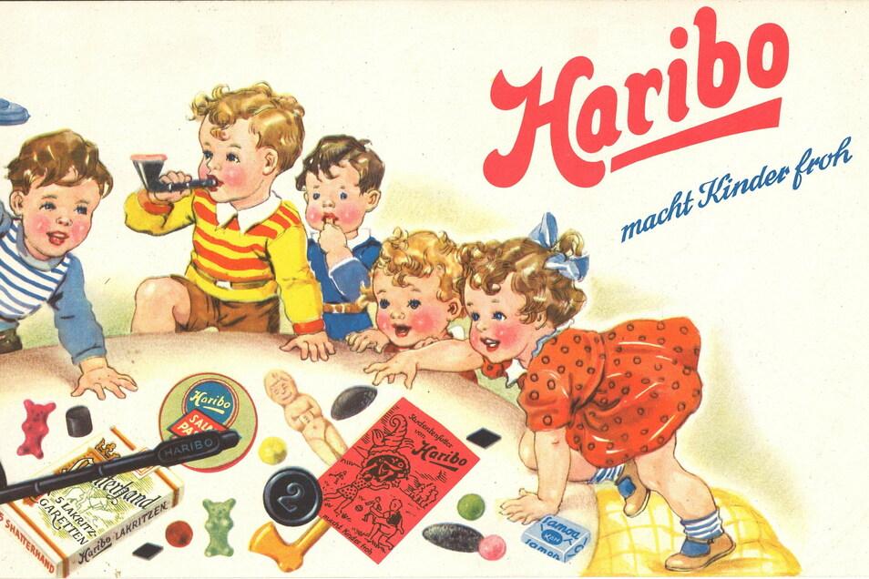 """Ein Werbeplakat des Süßwaren-Herstellers Haribo mit dem Werbeslogan """"Haribo macht Kinder froh"""" aus den 1950er-Jahren."""