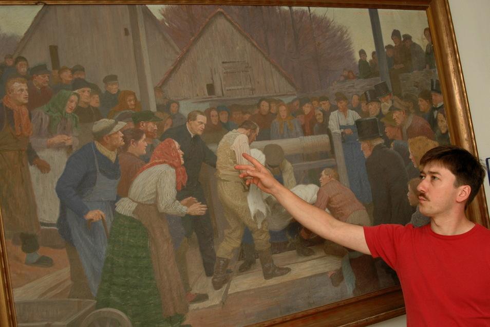 Pfarrer Frank Dregennus am Bild des Ponickauer Brunnenwunders.