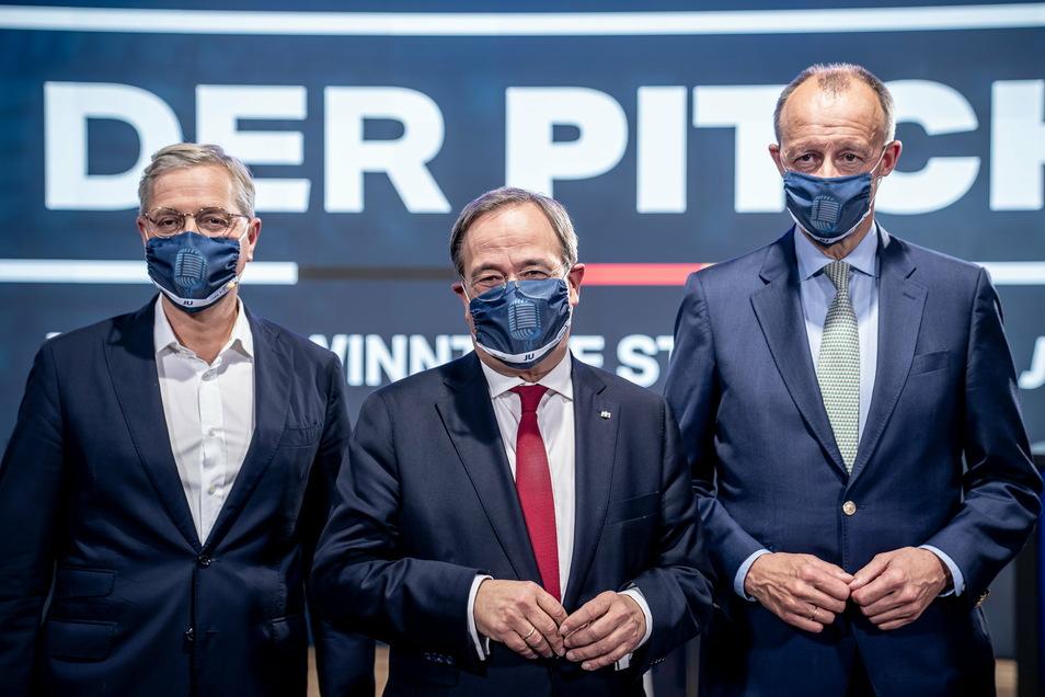 Armin Laschet (M), Friedrich Merz (r) und Norbert Röttgen (l) bewerben sich um den Vorsitz der CDU.