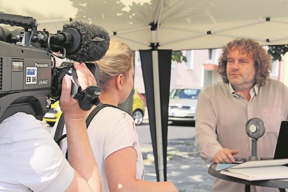 """Die Medien - hier der MDR - haben Torsten Pötzsch schon des Öfteren vor der Kamera gehabt,hier bei der """"OB-Gerüchteküche"""". Das Format, das dazu dient, mit den Bürgern ins Gespräch zu kommen, hat schon für Preise gesorgt."""