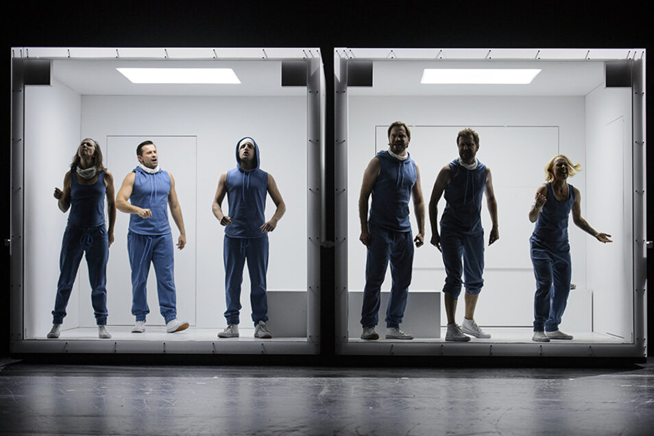 Sechs Protagonisten, eingesperrt in einem System aus Räumen, aus dem sie augenscheinlich nicht entkommen können