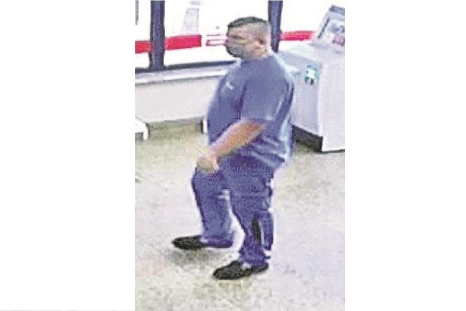 Das Foto der Überwachungskamera der Bank zeigt den gesuchten Mann.