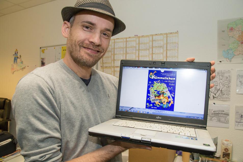 Der Nieskyer Cartoonist Kümmel nimmt sein neues Deutschland-Puzzle – hier noch im Computer – mit zur Starpyramide nach Hamburg.