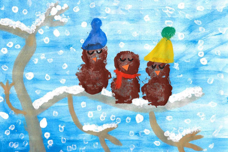 """Jasmin Berthold hat im Unterricht aufmerksam dem Gedicht """"Die 3 Spatzen"""" gelauscht und setzte den Inhalt mit Wasserfarbe bildlich um. """"Bei dem Schneetreiben kann nur eine Mütze schützen"""", meint die Neunjährige."""