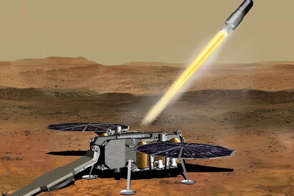 Ein Roboter soll Kapseln mit Proben von der Oberfläche des Mars aus in die Umlaufbahn des Planeten befördert. Von dort würde ein Raumschiff der Esa sie übernehmen und die Proben zur Erde bringen.