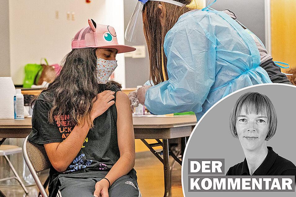 Eine Schülerin wird in den USA gegen Corona geimpft.