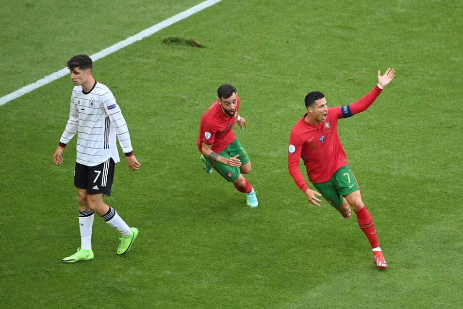 Portugals Cristiano Ronaldo (r.) bejubelt sein Tor zum 1:0. Es war sein erstes Tor überhaupt gegen Deutschland. Am Ende reichte es aber nicht.