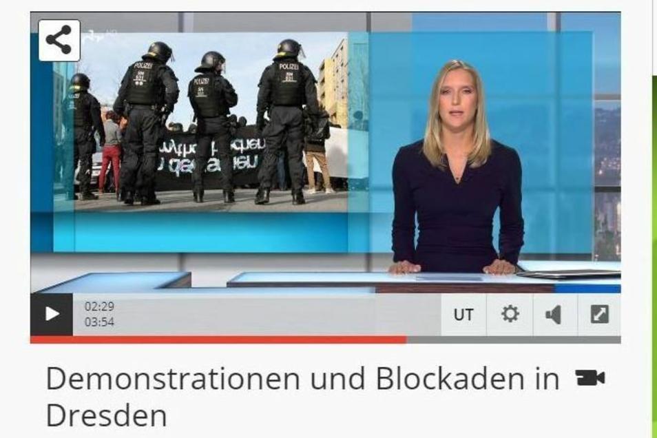Die MDR-Moderation mit dem bearbeiteten Bild zur Demo in Dresden.