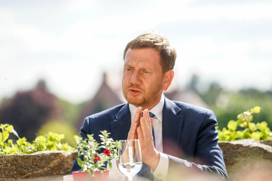 Sachsens Ministerpräsident Michael Kretschmer bei einem Gespräch mit Gastronomen und Hoteliers in Bautzen.