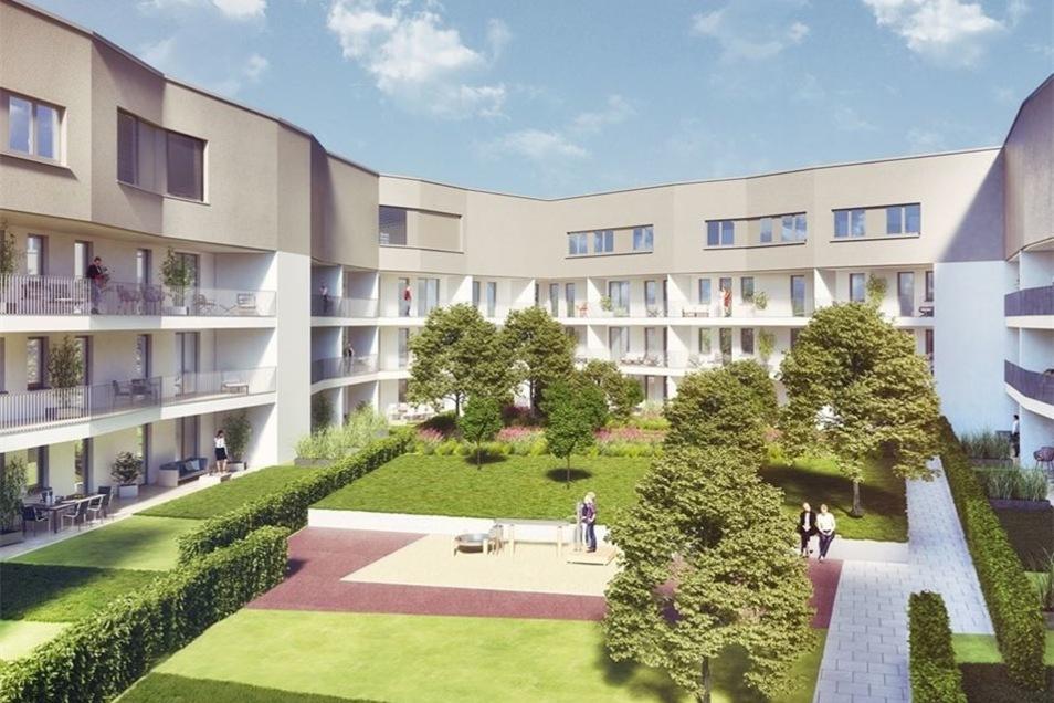 Im Innenhof des Neubaus gibt es viel Grün. Balkone und Terrassen der 68 Wohnungen zeigen nach innen.