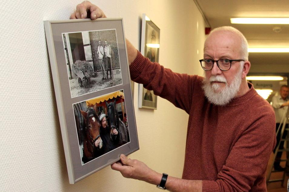 Andreas Meschke bei dem, was er auch weiter machen wird: dem Aufhängen von Fotos für eine Ausstellung. Hier war es Anfang vorigen Jahres im Pirnaer Klinikum.