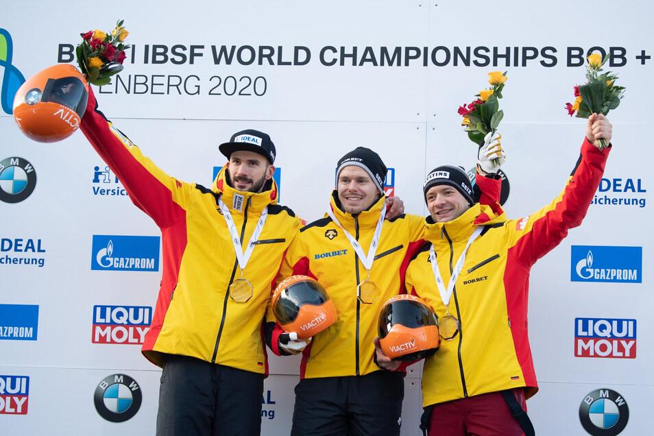 Axel Jungk (links), Christopher Grotheer (Mitte) und Alexander Gassner haben das Podest bei der Skeleton-WM in Altenberg für sich allein.