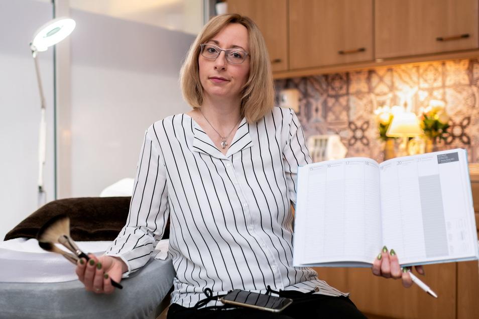 Das Telefon klingelt bei Andrea Eisebith oft nur, weil Kundinnen absagen. Die Folge: ein leeres Bestellbuch.