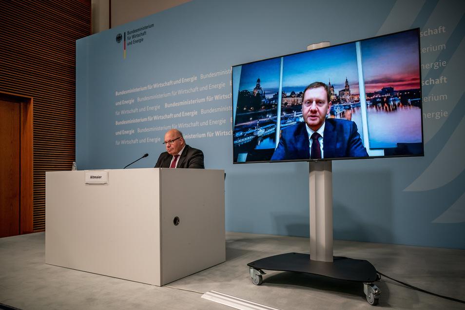 Auch Sachsens Ministerpräsident Michael Kretschmer (CDU) war nur über einen Monitor zugeschaltet.