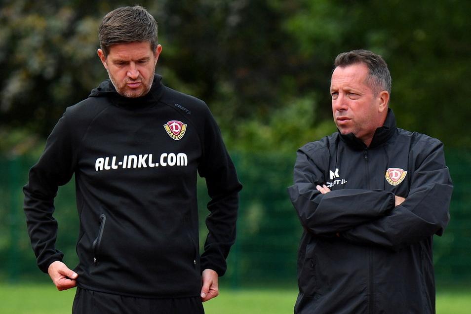 Sportgeschäftsführer Ralf Becker (l.) trifft Ende April die Entscheidung: Trainer Markus Kauczinski muss bei Dynamo gehen.