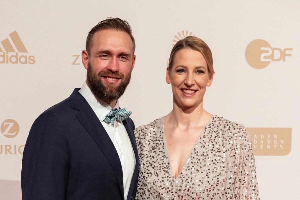Julia und Robert Harting, beide Diskuswerfer, teilen sich die Betreuung ihrer Zwillinge auf.