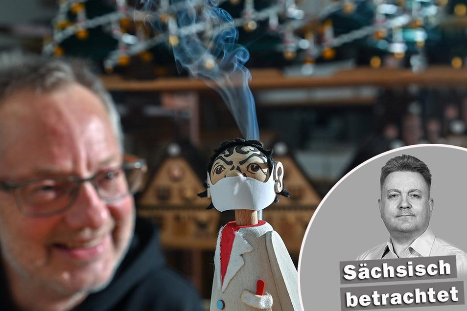 Spielzeugmacher Tino Günther mit seinem Virologen-Räuchermann - der stark an den Charité-Virologen Christian Drosten erinnert.