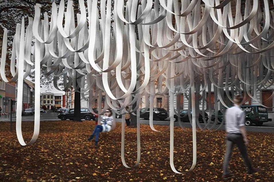 """Nach Feierabend in den Wolken schaukeln. Das funktioniert mit der studentischen Installation """"Wolkenschaukel"""". Aus der Ferne sollen die Bänder in den Bäumen am Otto-Buchwitz-Platz an eine Wolke erinnern. Sich reinsetzen darf  man wirklich."""