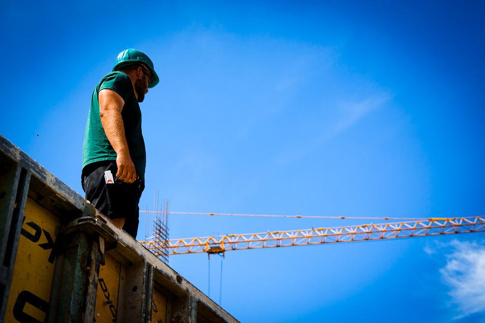 Bauarbeiter bekommen eine Corona-Prämie, allerdings nur, wenn sie in einer tarifgebundenen Firma tätig sind.