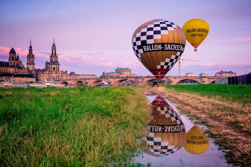 Das Königsufer in Dresden bot die entsprechende Kulisse für die jüngste Ballon-Taufe. Links im Bild der neue Ausbildungsballon für zwei bis vier Passagiere. Foto: PR/ DDPIX