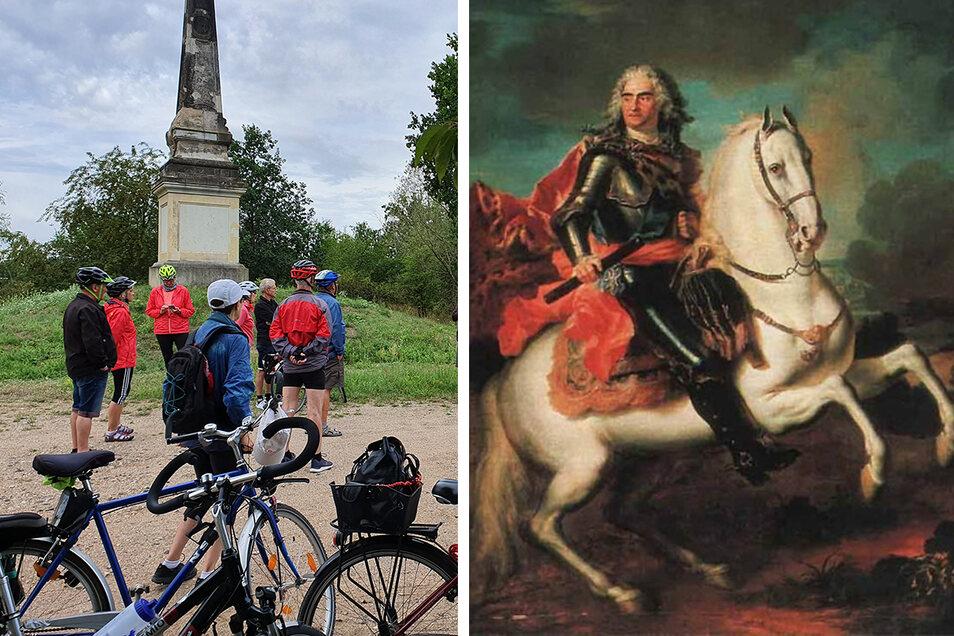 Radtouristen besuchen einen der sechs Obelisken, mit dem das Zeithainer Lustlager von August dem Starken markiert wurde.