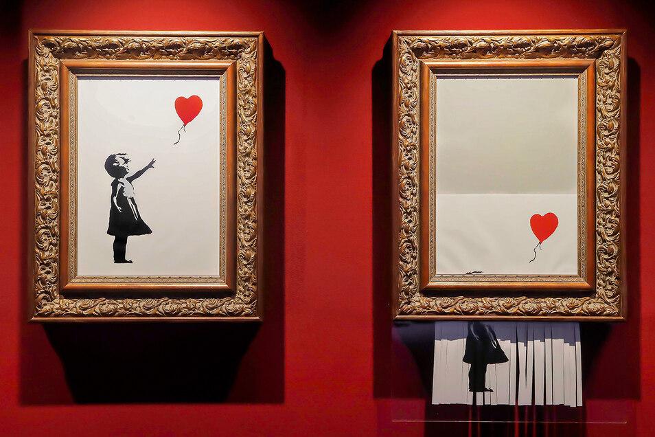 """Erst hieß es """"Girl with Balloon"""" (""""Mädchen mit Ballon""""), dann """"Love is in the Bin"""" (""""Die Liebe ist im Eimer""""). Das Banksy-Bild (Reproduktion, oben) hatte sich kurz nach seiner Versteigerung selbst zerstört, kurz nachdem es für circa 1,2 Millionen Euro ver"""