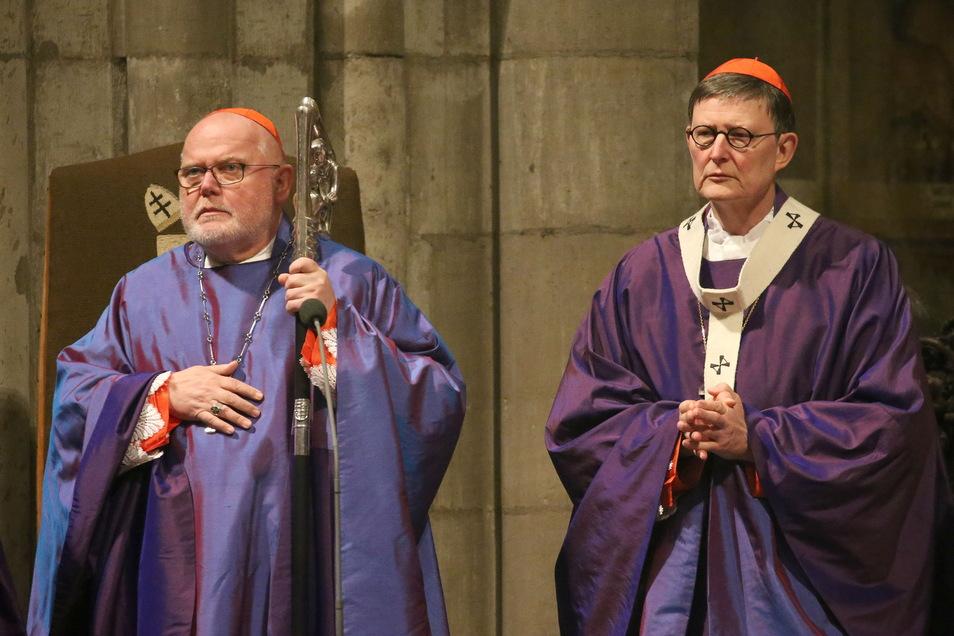 Kardinal Reinhard Marx und der Kölner Erzbischof Rainer Maria Woelki stehen wegen des Umgangs mit Missbrauchsfällen in der Kritik.